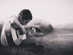 child-guitar-playing