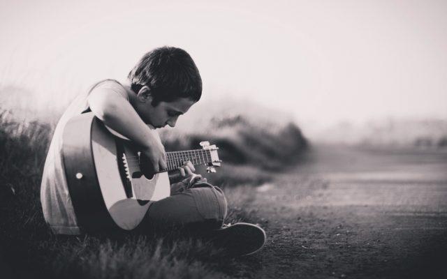 child-guitar-playing
